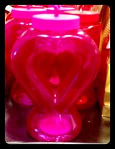 Hot pink sippy cup - whoever receives this is ONE lucky lady.  Then again, it could come in handy for alcoholic beverages?
